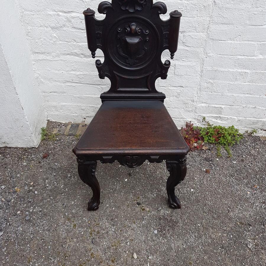 Nineteenth century ebonised oak hall chair
